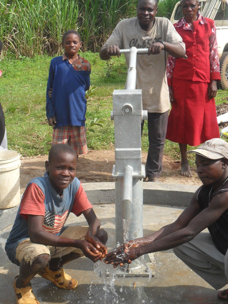 The Water Project : water-flowing-from-emayungu-pump