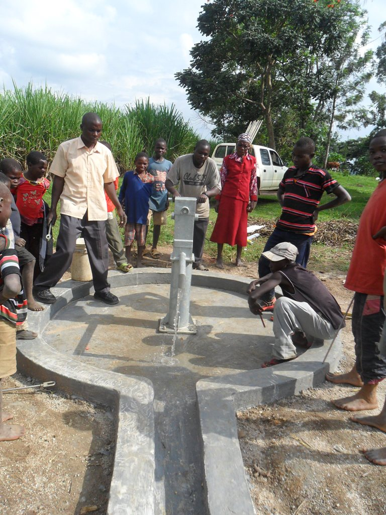 The Water Project : water-flowing-from-mayungu