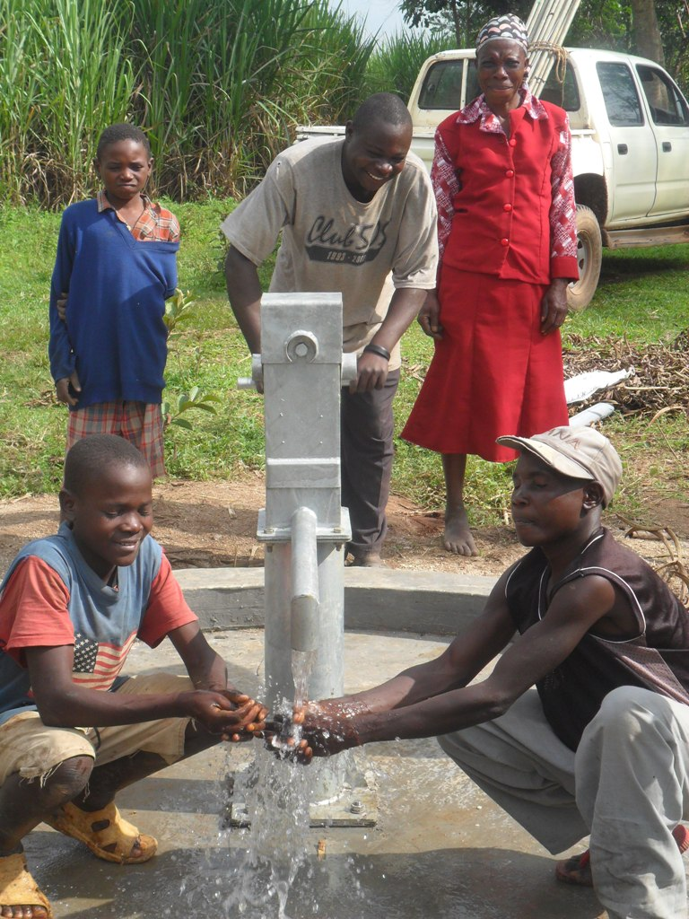 The Water Project : water-flowing-from-mayungu-water-project