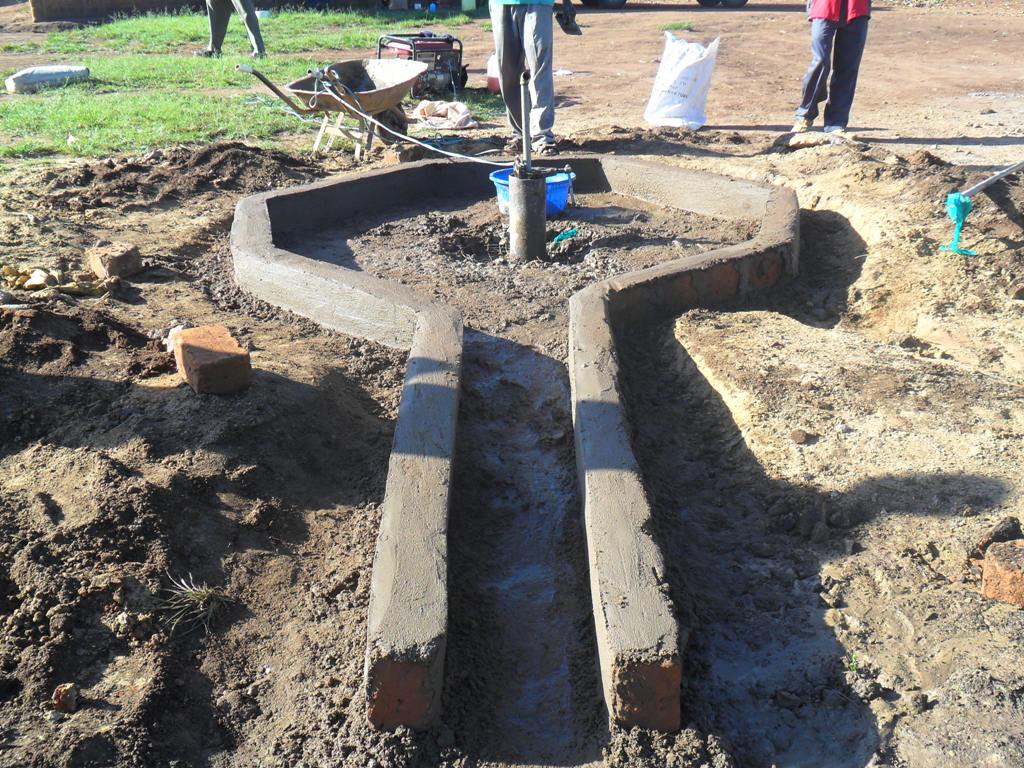The Water Project : pad-construction-nabingenge-primary