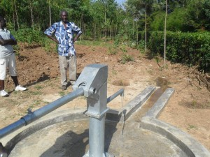 The Water Project : eshiamache-well-water-flowing-1