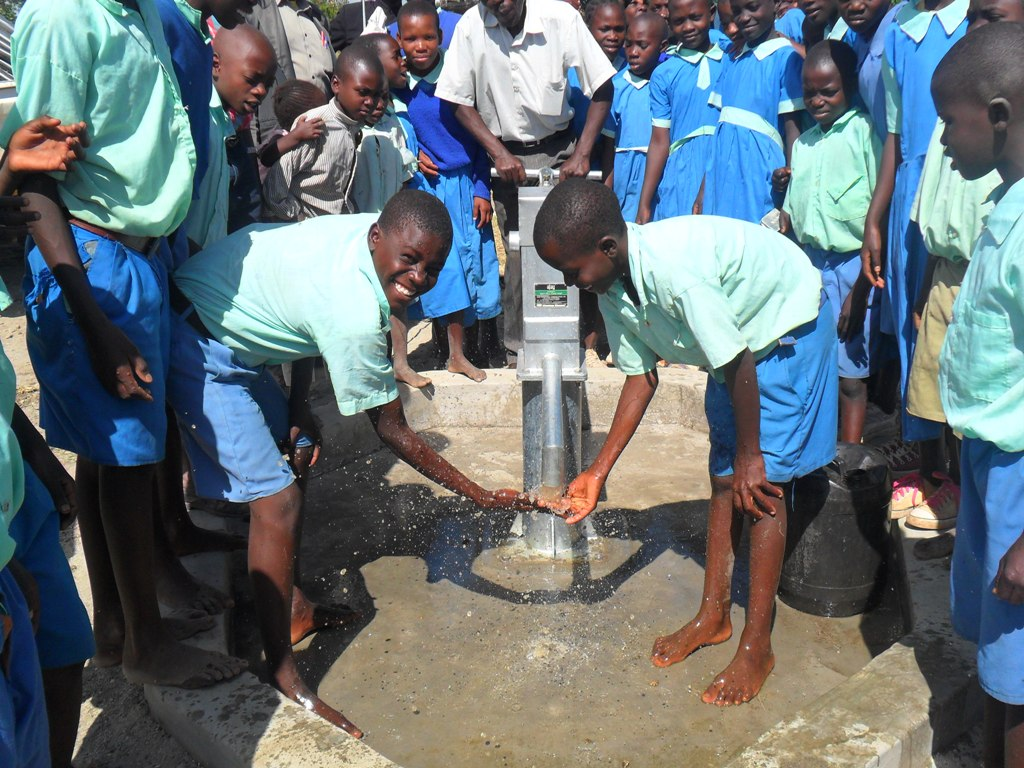 The Water Project : happy-soysambu-pupils-fetching-water-2