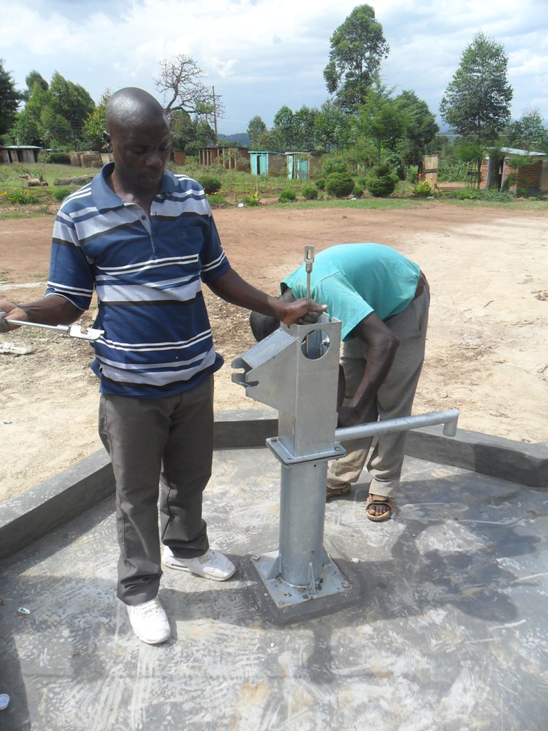 The Water Project : pump-installation-nabingenge-primary-1-2
