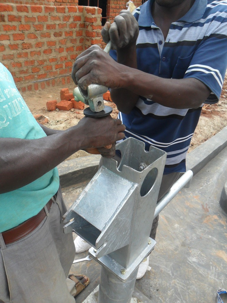 The Water Project : pump-installation-sabata-primary-2-2