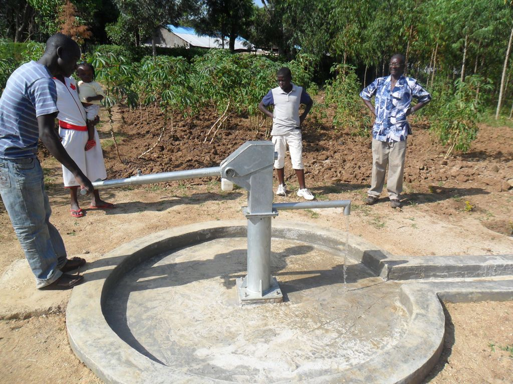 The Water Project : water-flowing-eshiamache-community-well-2