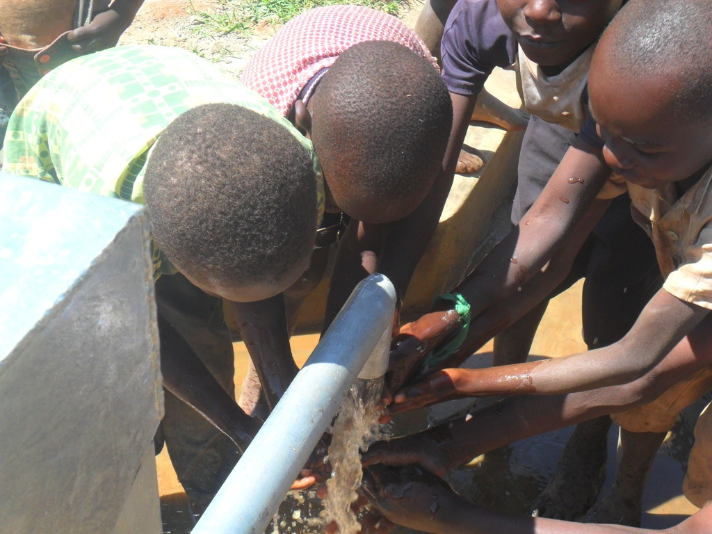 The Water Project : water-flowing-hofaland-primary-1-2