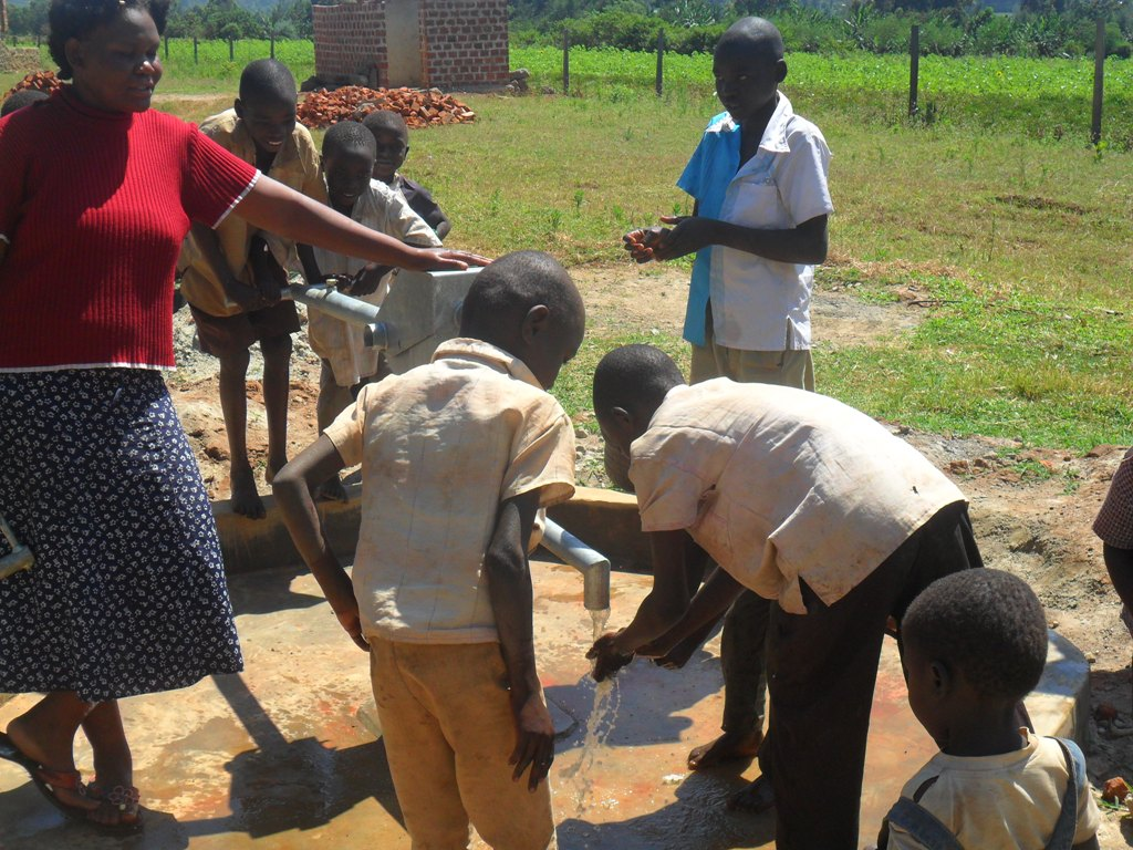 The Water Project : water-flowing-hofaland-primary-2-2