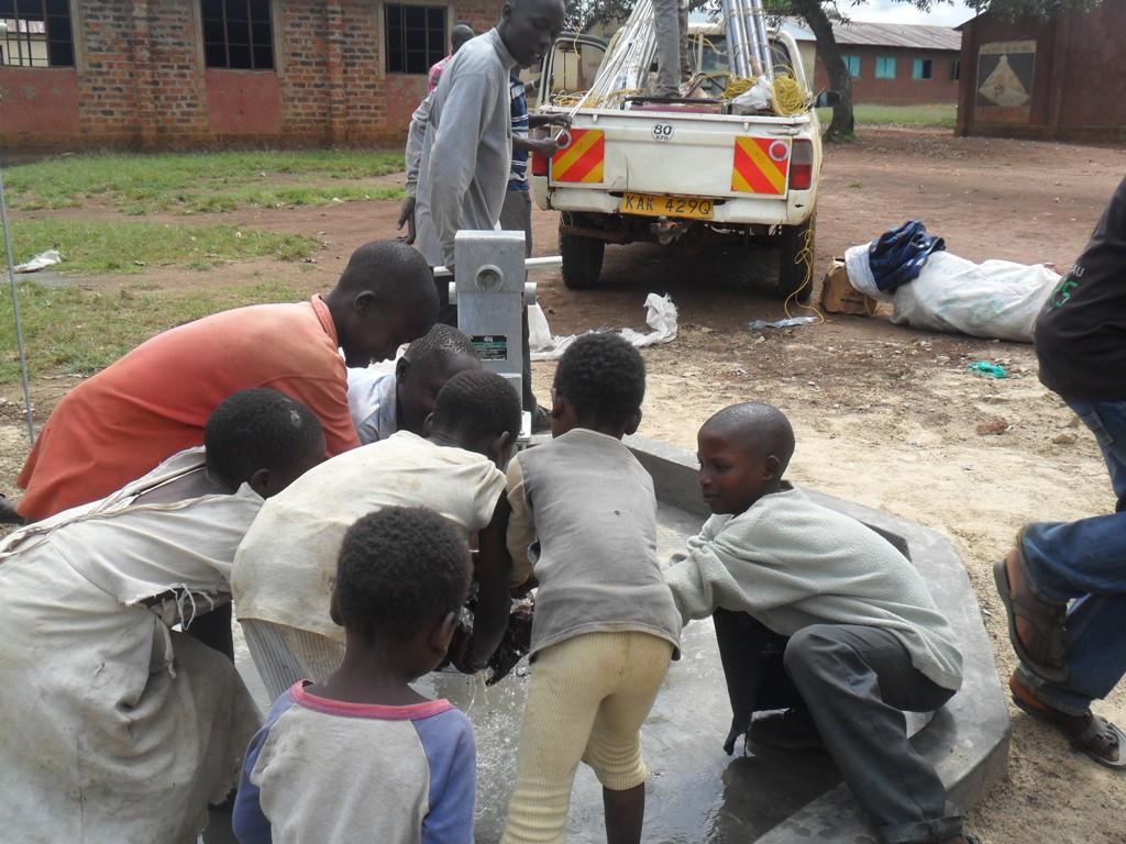 The Water Project : water-flowing-nabingenge-primary-1-2