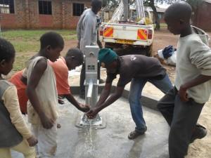 The Water Project : water-flowing-nabingenge-primary