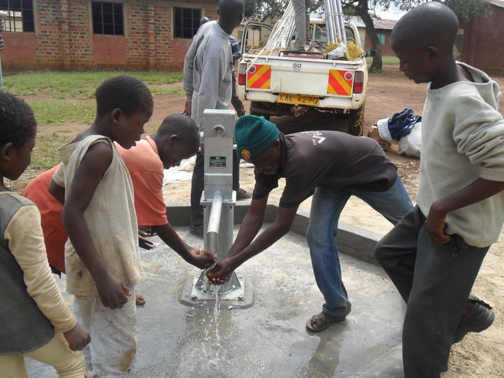 The Water Project : water-flowing-nabingenge-primary-2