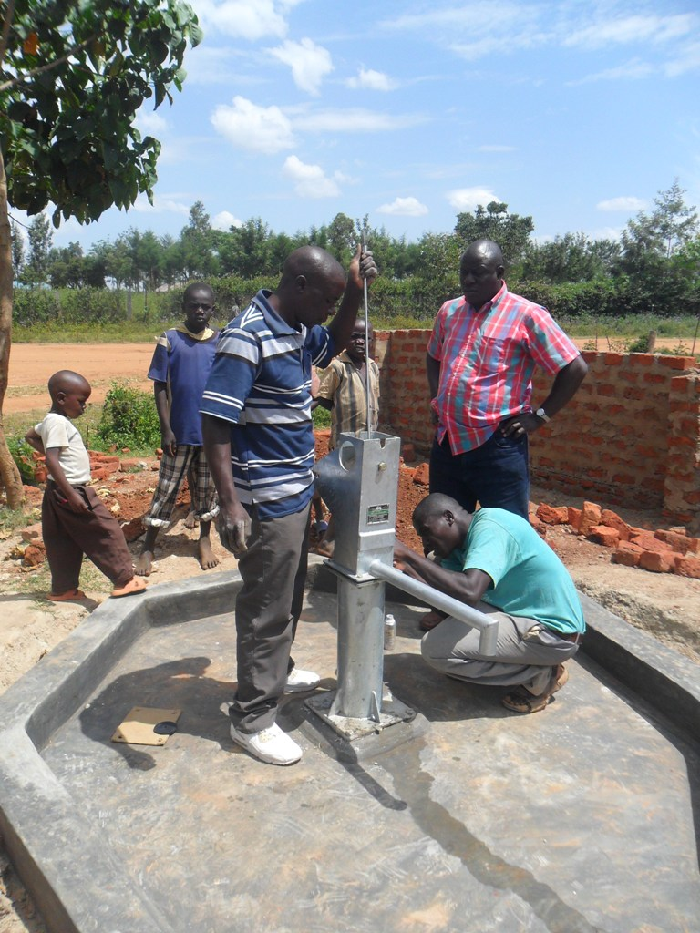 The Water Project : pump-installation-sabata-primary-1-2