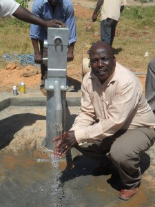 The Water Project : bushiangala-technical-institue-deputy-principal-washing-hands