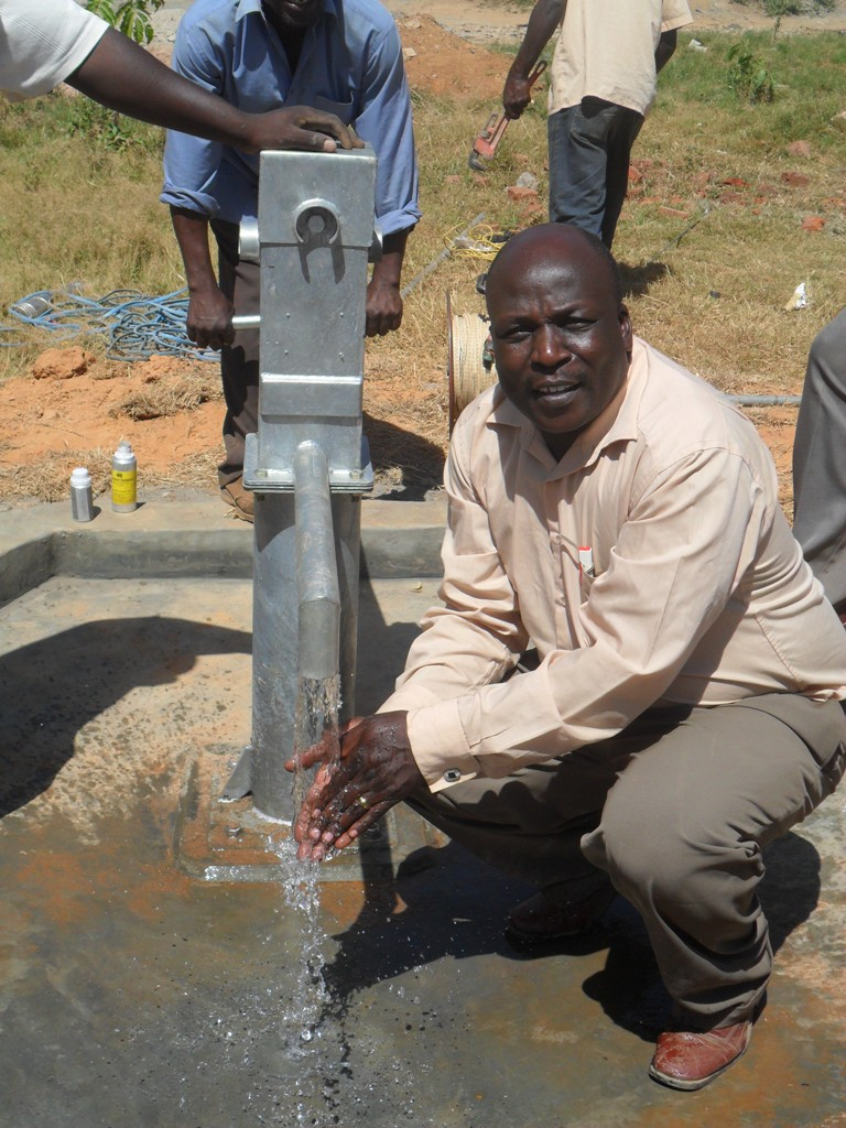 The Water Project : bushiangala-technical-institue-deputy-principal-washing-hands-2