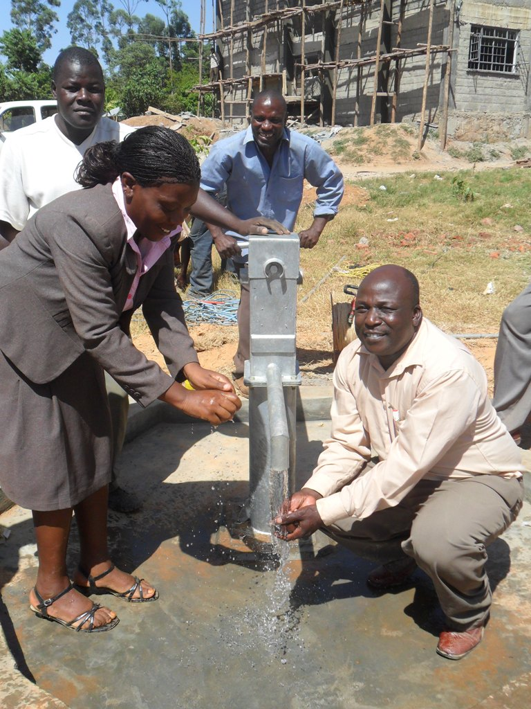 The Water Project : happy-bushiangala-technical-institute-staff-washing-hands-2