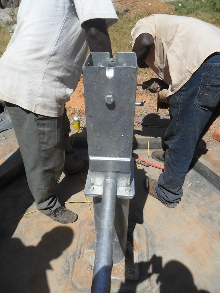 The Water Project : pump-installation-bushaingala-institute-2
