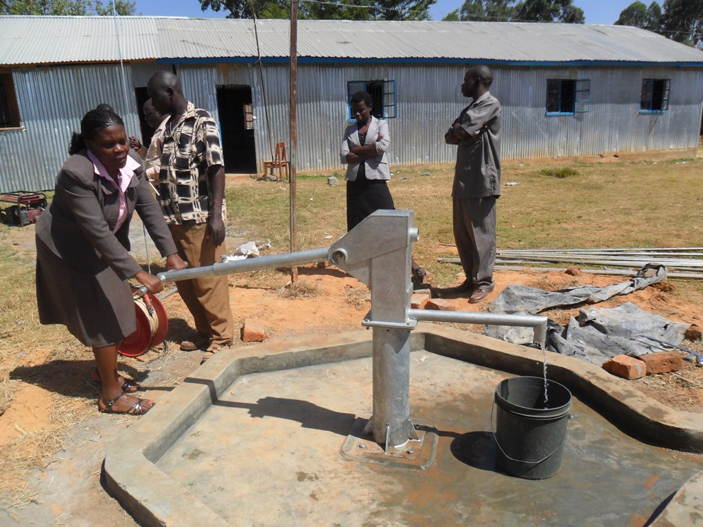 The Water Project : water-flowing-bushiangala-technical-institute-1-2