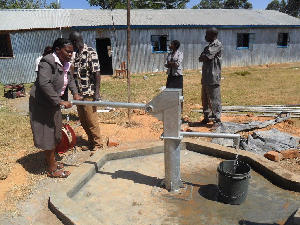 The Water Project : water-flowing-bushiangala-technical-institute-2