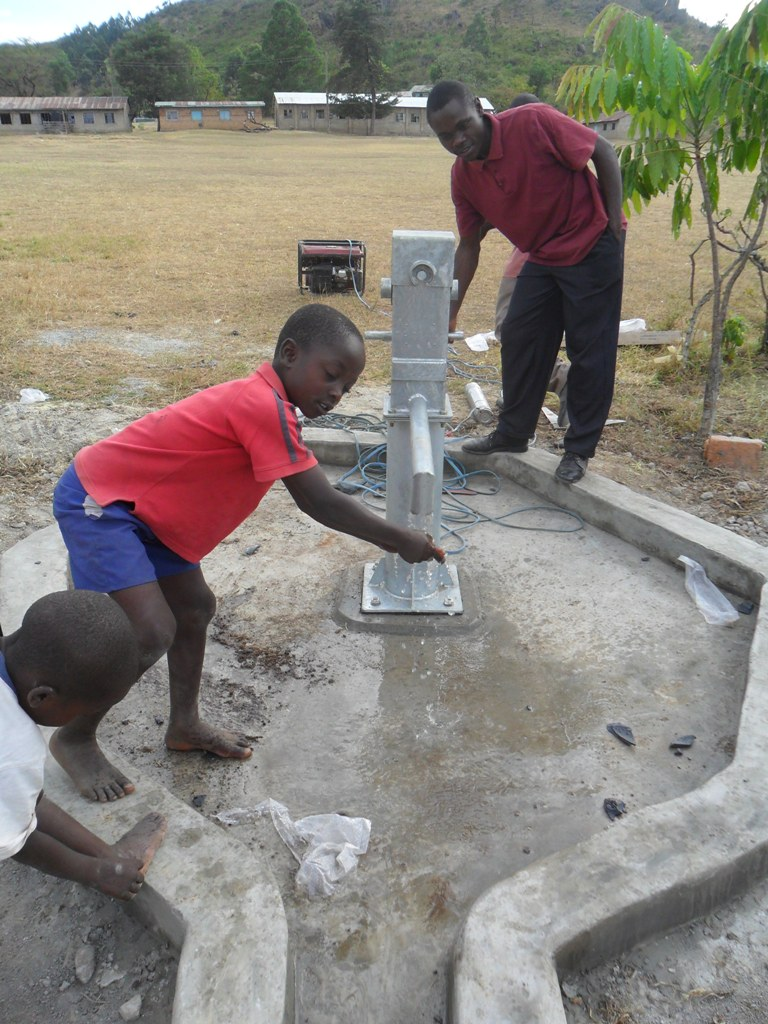 The Water Project : water-flowing-magale-secondary-3