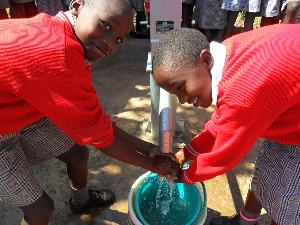 The Water Project : handing-over-bishop-muge-5