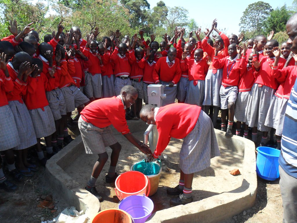 The Water Project : handing-over-bishop-muge-4-2