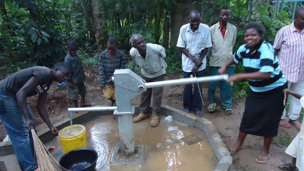 The Water Project : water-flowing-wazee-hukumbuka-001-2