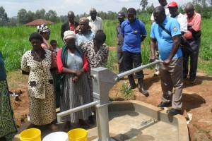 The Water Project : eshibinga-community-commissioning-of-the-well