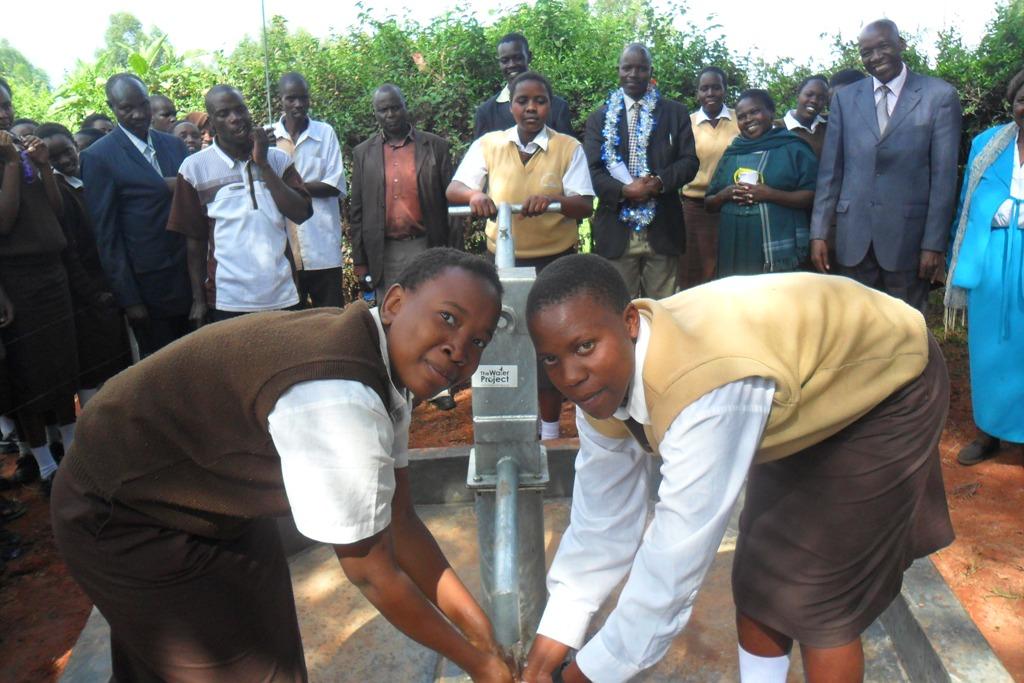 The Water Project : kositan-girls-handing-over-_1-2