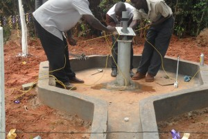 The Water Project : kositan-girls-pump-installation-001