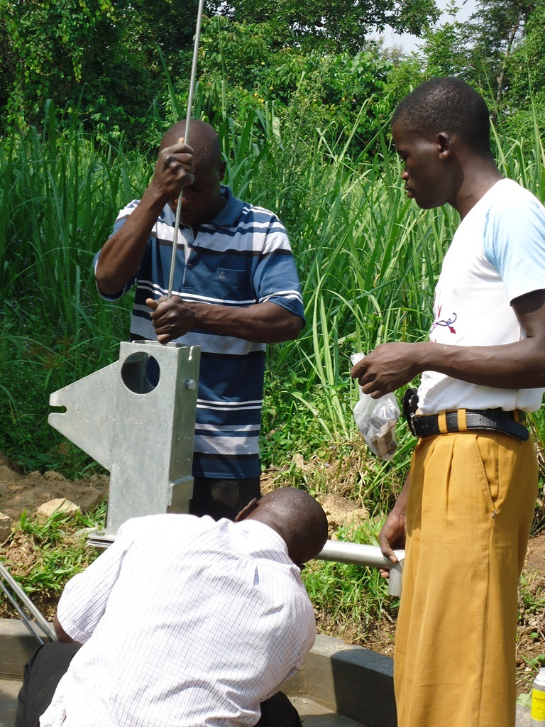 The Water Project : pump-installation-njirinya-self-help-group-3