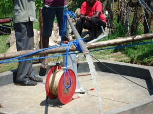 The Water Project : test-pumping-surungai-community-3