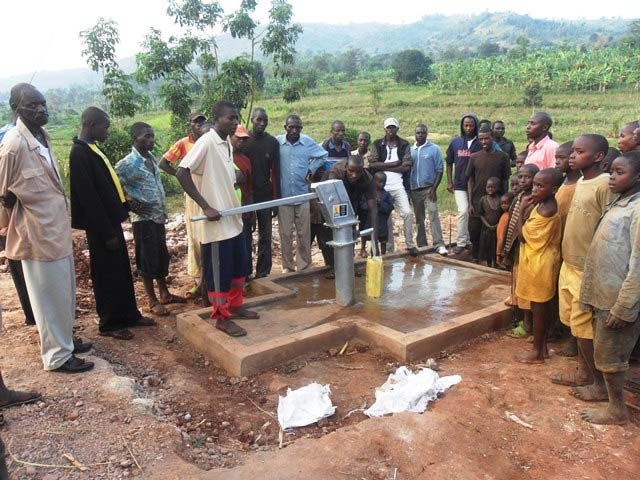 Image result for water well far away from rwandan village