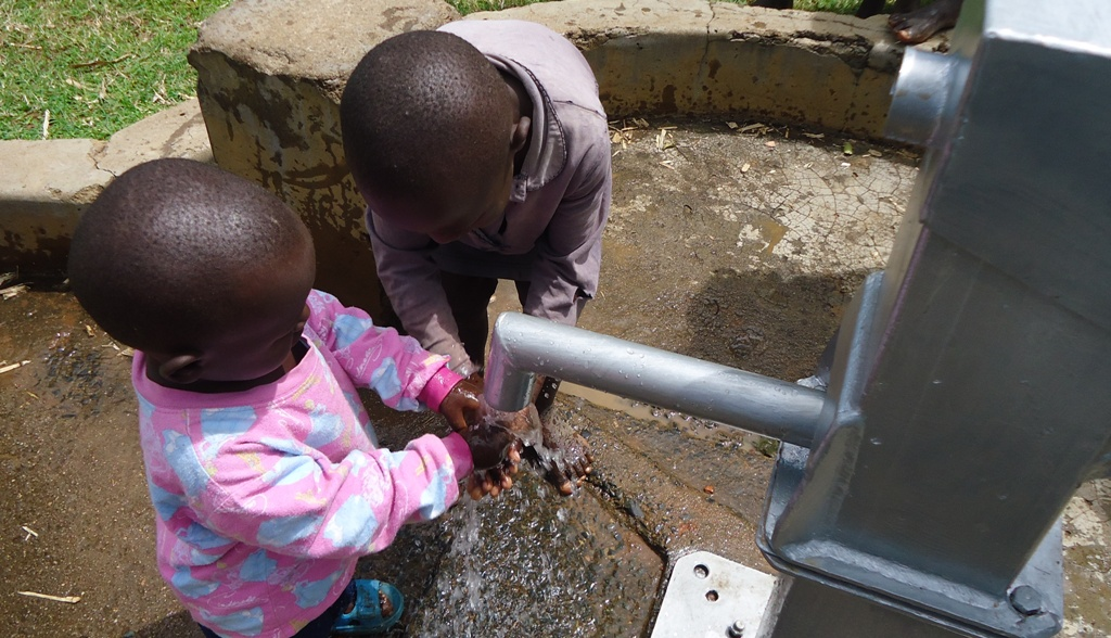 The Water Project : bukaya-community-water-flowing-3