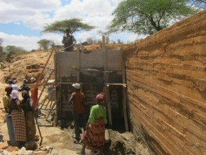 The Water Project : maiuni-sand-dam-shg_water-tank_october-2012-3