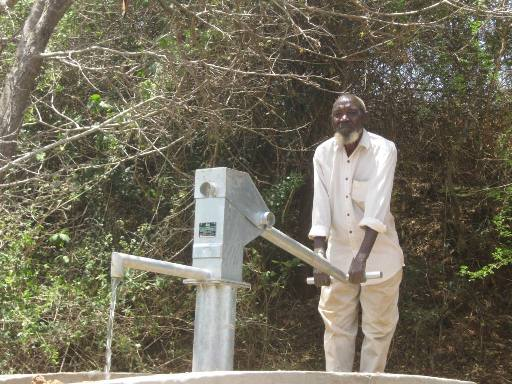The Water Project : wuumisyo-wa-kiumoni-shg_member-mr-mandela-at-the-shallow-well_october-2012-3