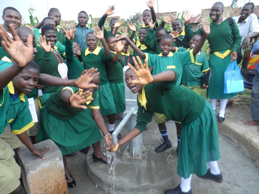 The Water Project : ekambara-primary-school-water-flowing-1-2