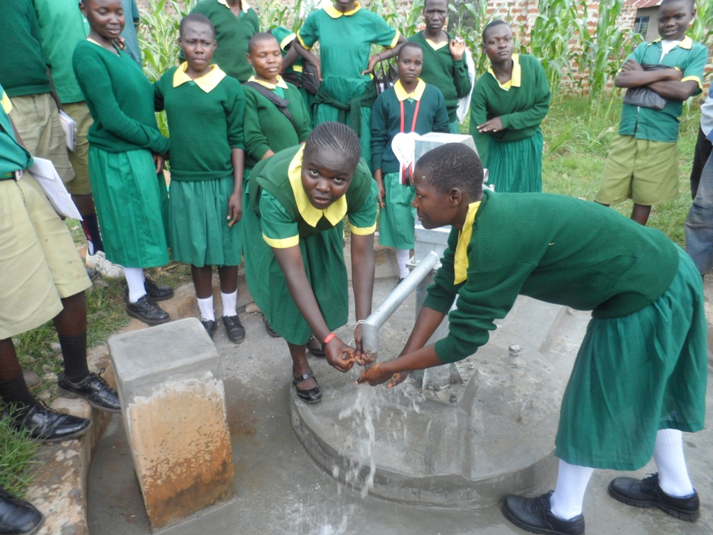 The Water Project : ekambara-primary-school-water-flowing-2-2