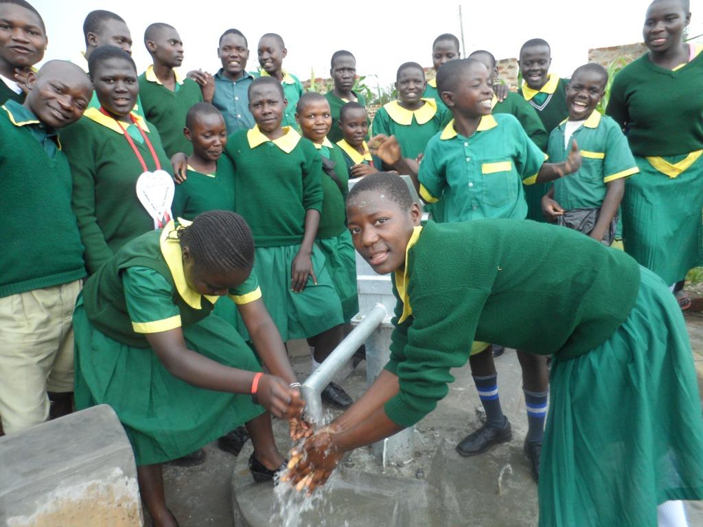 The Water Project : ekambara-primary-school-water-flowing-3-2