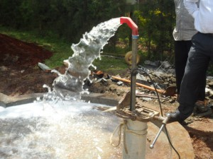 The Water Project : kenya4156_test-pumping-4