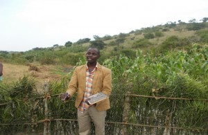 Emmanuel M. - Farmer, discussing her newly donated water project in Uganda