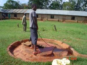 The Water Project : kenya4164-community-member-drawing-water