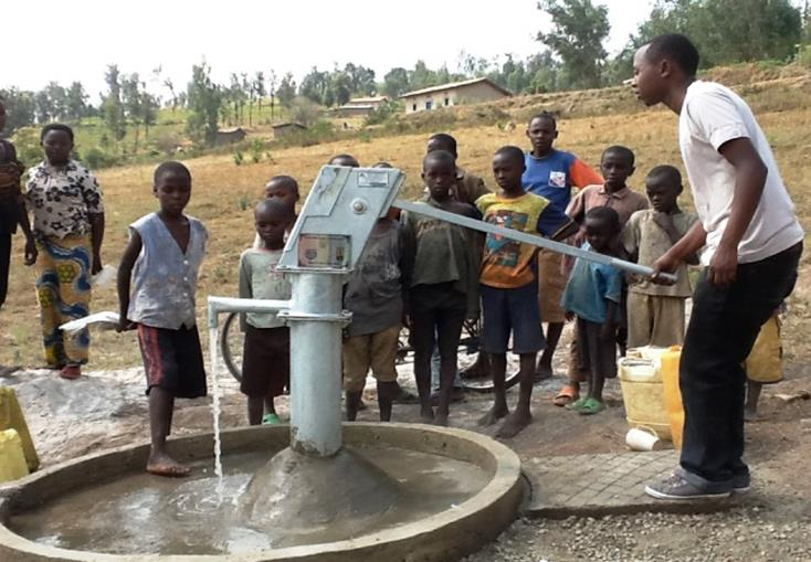 The Water Project : rwanda3068-water-flowing-1