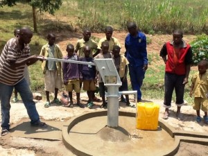 The Water Project : rwanda3070-water-flowing-2