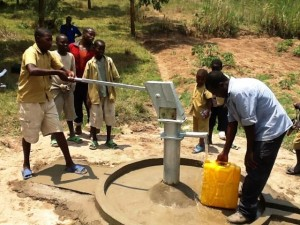 The Water Project : rwanda3070-water-flowing-3
