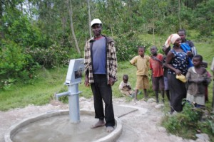 Raurent G - Farmer and Small Business Owner, discussing her newly donated water project in Rwanda
