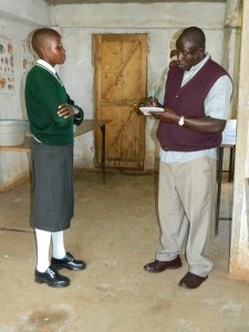 The Water Project : kenya4221-07-mr-makongo-interviewing-one-of-the-students