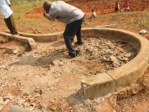 The Water Project : kenya4248-19-imakale-reparing-the-well-pad