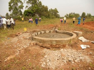 The Water Project : kenya4248-21-imakale-reparing-the-well-pad