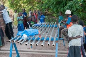 The Water Project : burkinafaso9055-12-prepping-new-pump-materials