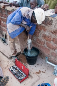 The Water Project : burkinafaso9055-14-testing-the-new-pump-cylinder