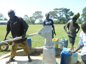 The Water Project : kenya4213-19-community-members-fetching-water-after-pump-was-installed